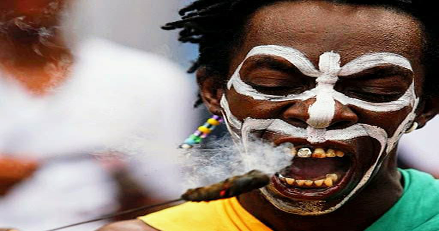 Black man dressed as spirit during Cuba carnival